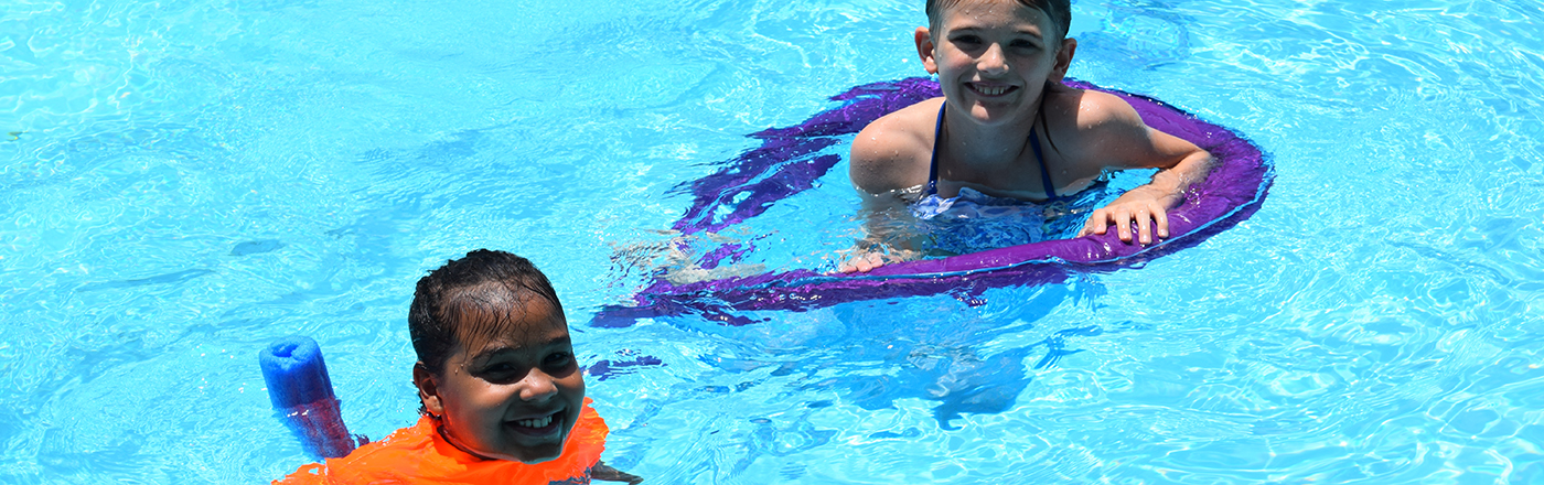 students smiling in pool